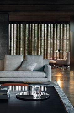 Dark Moody Interior | Grey Sofa and Rug with dappled afternoon light through Timber Screens