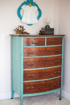 Give a wooden dresser a modern update by painting all of the surfaces except the front of the drawers. The colorful case sets off the unique grain of the exposed wood.  See more at It's Two AM »