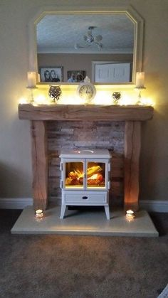 45 Cool Electric Fireplace Designs Ideas For Living Room - Wohnung Faux Fireplace Mantels, Small Fireplace, Bedroom Fireplace, Fireplace Remodel, Living Room With Fireplace, Fireplace Surrounds, Fireplace Design, Fireplace Ideas, Oak Beam Fireplace