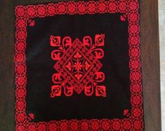 Cushion with handmade cross-stitch embroidery