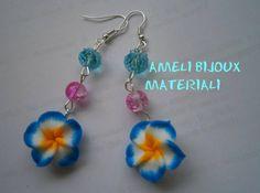 orecchini eleganti con fiore celeste