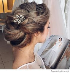 Beautiful updo with a hair accessory for the braid