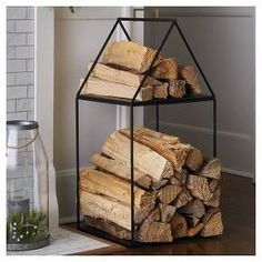 Keep your fireplace neat, organized and feeling incredibly cozy with this House Log Holder from Hearth & Hand™ with Magnolia. This house-shaped log holder features a simple linear design with a sturdy iron construction in a black finish. The roof has a gold handle so you can lift it off to move your wood logs around easily. You can store your firewood in a functional and beautifully designed iron log holder in the shape of a house.<br><br>Celebrate the everyday with H... Affordable Home Decor, Cheap Home Decor, Fixer Upper Living Room, Living Rooms, Living Spaces, Log Holder, Target Home Decor, Chip And Joanna Gaines, Herd