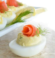 This Smoked Salmon Deviled Eggs Recipe is the best way to use those leftover Easter eggs! Creamy deviled eggs topped with smoked salmon, dill and lemon.