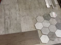 Love this honeycomb tile for feature wall in shower and concrete tile for floor