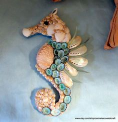 Cute seashell sea horse. Love the blueish and coral.