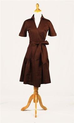 Brown wrap dress has large collar and cuffed sleeves.