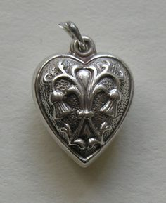 Vintage Thistle Sterling Puffy Heart Charm from redrobinantiques on Ruby Lane