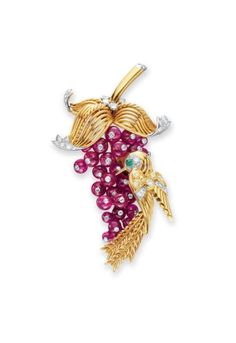A RETRO RUBY, DIAMOND AND GOLD BROOCH, BY MARCHAK  -  Designed as a cascading cluster of ruby bead berries, each topped by a collet-set diamond, enhanced by a sculpted 18k gold hummingbird, with a cabochon emerald and circular-cut diamond eye, its wings decorated with circular-cut light yellow and single-cut diamonds, suspended from 18k gold wirework leaves and polished gold stem, accented by circular-cut diamonds, mounted in 18k gold and platinum, circa 1940. | Christie's