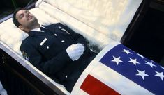 Young police officer in his coffin