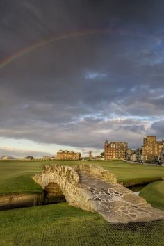 """""""St Andrews Bridge"""" by Chris Frost The famous Swilken Bridge on the 18th Holes of Golf's home, St. Andrews Old Course on a late summer's bringing with it a perfect rainbow."""