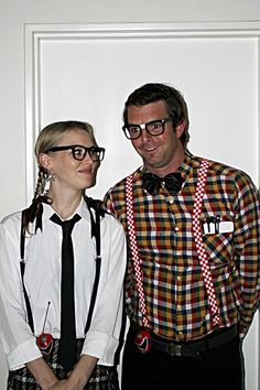 Couples' Halloween nerd costumes complete with glasses and suspenders