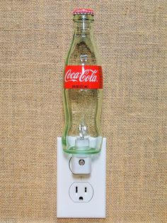 Created from a Recycled 8oz. Coca-Cola glass bottle using a quality UL listed Night Light Fixture for use in a vertically positioned outlet. Included is an incandescent bulb operated with an automatic dusk to dawn light sensor. If you look closely at the back of the bottle you will see