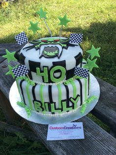Arctic Cat - 40th Birthday. Racing flags, stars and green ribbons. This vanilla cake is tinted green for the other arctic cat enthusiast. Fully wrapped in fondant and decorated with fondant racing stripes and checkered flag on top is a custom created Arctic cat cat b  Find and follow my on Facebook Custom Creations Sudbury