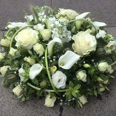 SYMPATHY Say goodbye to a loved one with a personal and thoughtful flower arrangement. The Broadway Florist will work with you to achieve this, incorporating elements that are meaningful to you both. POSY PADS Start from WREATH RINGS Funeral Floral Arrangements, White Flower Arrangements, Floral Centerpieces, Grave Flowers, Church Flowers, Funeral Flowers, White Flowers, Beautiful Flowers, Exotic Flowers