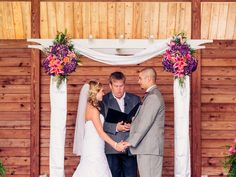 Purple and Orange ceremony arch. Richard Bell Photography