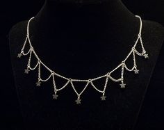 light silver with hematite stars contrasting choker. $23.00, via Etsy.