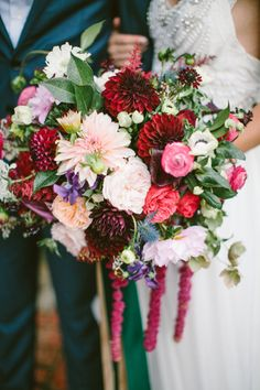 Romantic jewel toned dahlia wedding bouquet: http://www.stylemepretty.com/little-black-book-blog/2015/12/09/touch-of-boho-jewel-toned-wedding-inspiration/ | Photography: Brianna Wilbur - http://briannawilbur.com/