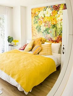 The idea of a large painting at the head of the bed...I love the yellow!!