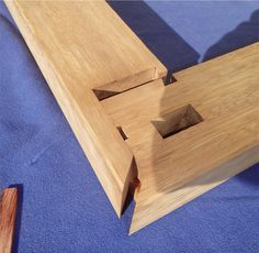 Designing and building structures with solid wood, emphasizing joinery without glue or metal fasteners.