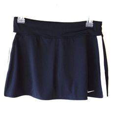NIKE Dri-Fit Tennis Skort NWOT - Nike Dri-Fit black with white trim stretch Skort/Shorts.  Washed and Cut tag out before realizing they were too small. My old bad habit! Nike Skirts