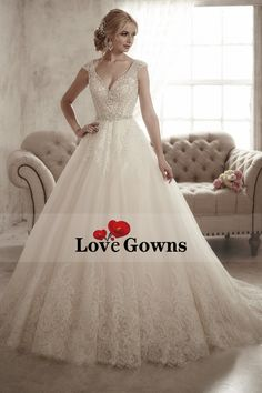 2016 A Line Open Back V Neck Wedding Dresses Tulle With Applique And Beading Chapel Train