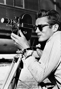 James Dean with a 16mm Bolex camera on the set of GIANT (1955)