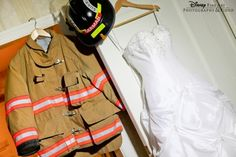 Wedding dress and firefighter uniform... only our shot would feature some popo blue instead :)