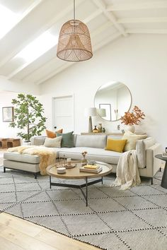 White Open Transitional Living Room - 10 Interior Design Mistakes And How To Fix Them: A big and open living room space is beautifully decorated in a transitional style with a good size rug and a well planned furniture layout a great example of some of the pitfalls to avoid when it comes to interior design. @chloedominik #transitionallivingroom #whitelivingroom #interiordesignmistakes #interiordesigntips #openlivingroom #openlivingroomlayout