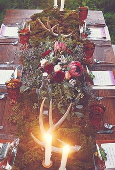 Fall-Inspired Wedding Table: Bohemian Tablescape of Green Moss, Red and Pink Flowers, and Antler Centerpieces | Brides.com