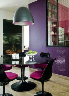 Dark purple walls and a pop of fuschia