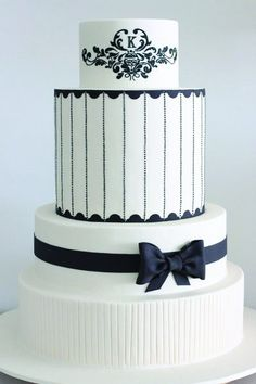 Love the clean lines of this Ivory and black wedding cake by www.sharonwee.com.au -- Grace Ormonde Wedding Style