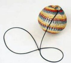 Crochet covered ball on elastic! I won this at my local fair. Managed to bounce it into my friend's pudding bowl one lunch time at school. Custard covered ball - not a good look!