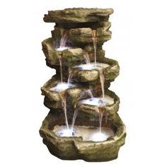 The Large 10 Fall Rock is a self contained water feature that looks like realistic rocks with green moss.