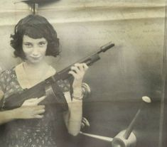 Madam Moll, Gangster from The Late 20's with her M1928 Thompson in front of a bank safe she just robbed