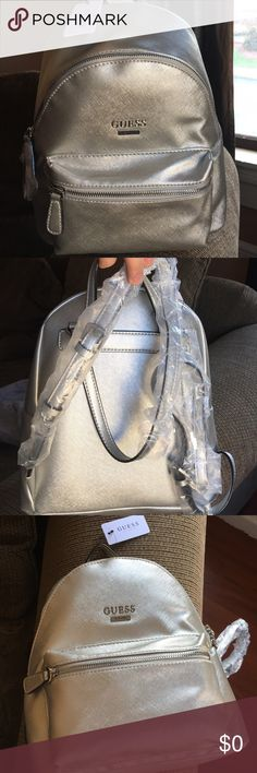 Guess ? Silver Backpack (medium sized) NWT Medium sized back pack. Silver. Faux leather. Guess Bags Backpacks