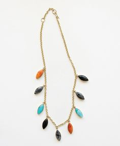 Semi-precious stones in shades inspired by a desert landscape adorn your neck for a touch of southwestern elegance.