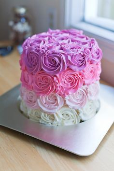 The elegant buttercream roses on the outside of this pink ombre cake are truly stunning. It's a real show stopper!