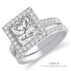 Love this 14K White Gold Diamond Halo Engagement Ring with vibrant accent diamonds.