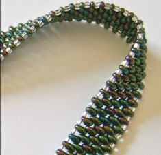 The Twin Beauty Bracelet is a wonderful project for anyone who wants to learn how to make woven bracelets with beads. This DIY bracelet pattern uses twin hole beads for a complex interlocking effect that is much easier to achieve than it looks.