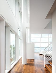 View of the living room, toward the water. Chinese Architecture, Modern Architecture House, Futuristic Architecture, Modern Houses, Richard Meier, Fire Island, Zaha Hadid Architects, Home Bedroom, Bedrooms