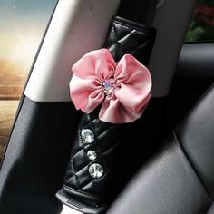 Black PU Seat Belt Cover with Pink Flower and Bling Rhinestones FEATURES Fully lined. Listing is for 1 piece. Can be customized (change flower to bow or change another color). Bling Car Accessories, Girls Accessories, Car Key Holder, Girly Car, Charms, Pink Bling, Crystal Flower, Cute Bows, 1 Piece