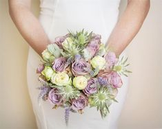 This pastel toned wedding bouquet features light green eryngium which is ideal for those who want a dreamy vintage feel to their flowers - they're in season in September!