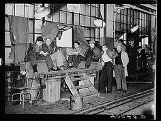 Strikers guarding window entrance to Fisher body plant number three. Flint, Michigan, Jan.-Feb. 1936. Photographer: Sheldon Dick.
