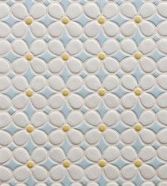 We drew inspiration for our ceramic tile Tilt collection from iconic 60s and 70s prints and lines. Shown here is the Daisy Pattern in Sunshine Blend, inspired by the Flower Power movement.