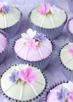 Pretty cupcakes with pink and purple sugar flowers