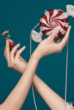 Keep things sweet with these darling Judith Leiber Couture minaudières. This whimsical accessory can be paired with a polished dress or tailored jumpsuit.