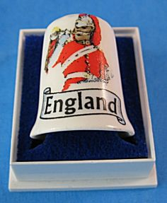 This is an English bone china thimble in it's original fitted box with a picture…