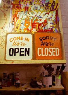 Store Front by Tristan Kerr. Open, Closed signs