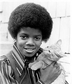 MJ (Lol even the kitty is shocked to be held by Michael Jackson)